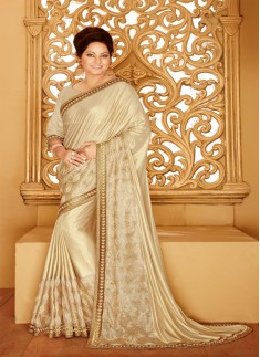 Designer saree with zari work and beige color