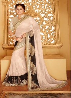 Designer saree with zari work and peach color