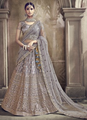 Elegant Lehenga Choli In Net Material With Heavy Work