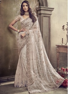 Elegant Net Saree With Decent Border And Heavy Work Blouse Piece