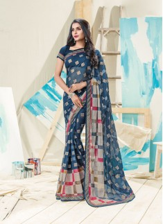 Nevy Blue Color Saree With Fancy Print And Skirt border Style